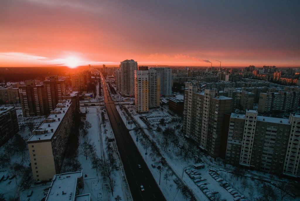 Birdseye View of snowy city during sunset.